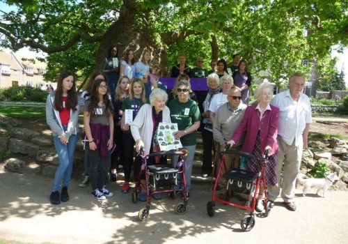 Westgate Gardens Tree Trail group photo with AGE UK clients and SL girls